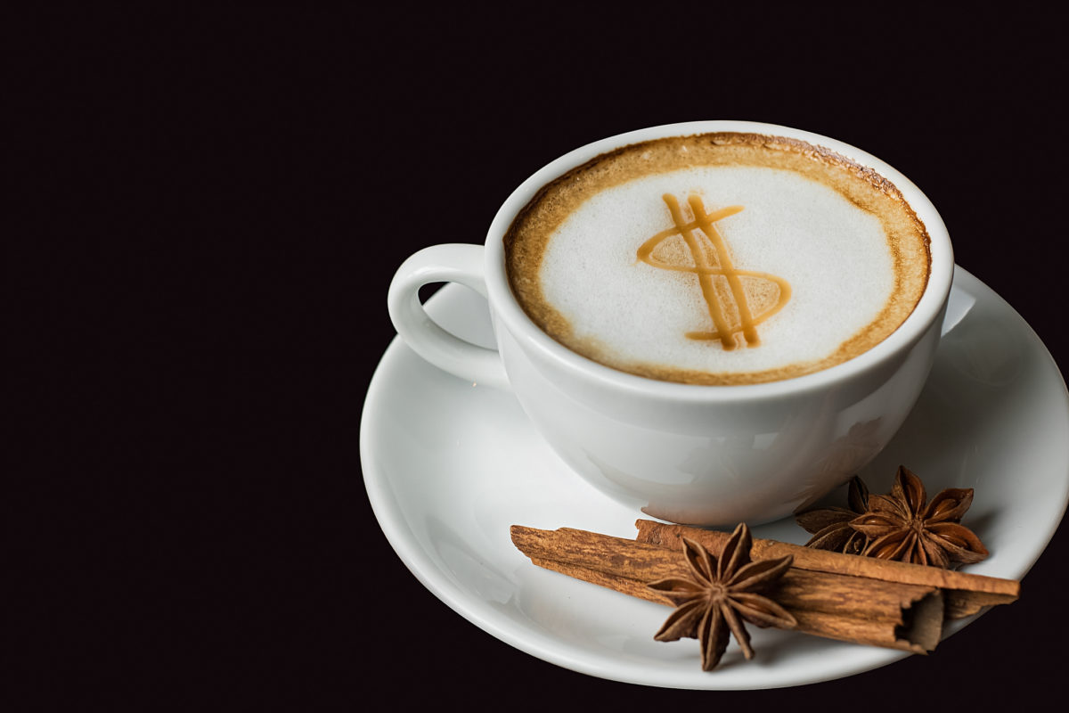 A latte with a dollar sign on it